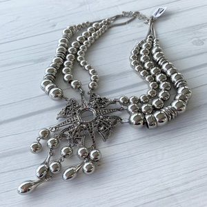 Free people ornate pendent statement necklace